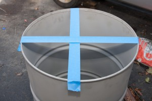 I used tape to mark center lines across the top of the drum. Once I had even marks    around, I made my holes for mounting the grate holder bolts, thermometer, handles, and thermocouple.